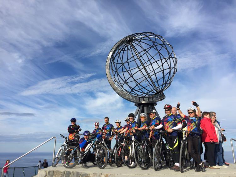 Bike team at globe Nordkapp Norway